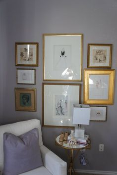 Gold frames jump out at the eye against the gray paint and furniture.