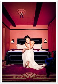 Love this shot in the bedroom of the Gramercy Park hotel... I think? I think the bed is the perfect foil for that gown... and her very unbridal pose is perfect!