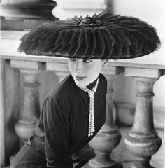Who needs an umbrella with a hat like this? Vintage fashion image by Norman Parkinson.