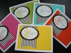 handmade notecard set ... like the formula: bright color paper embossed for background layer; fishtail banner in black and white stripes; black scalloped oval mat for focal point; and stamped flowers and sentiment words .... fun and lively card set!