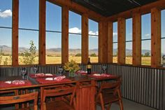 """2-1/2"""" Corrugated metal in dining room (I like the tin with wrap around windows much better than solid walls.)"""