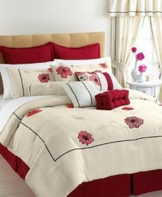 Bold and beautiful. Bright poppy blossoms bring a feminine sense of sophistication to the Penelope 4-piece comforter set from Vida by Eva Mendes. Intricate embroidery creates a graceful leaf design in a lustrous metallic shade, as well as accentuates the rich colors of each blossom. An array of exquisitely detailed pillows and a bright red bedskirt finish the look with fashion-forward flair.