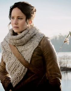 Katniss is so much braver in the catching fire movie than she was in the hunger games movie