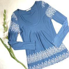 TESTAMENT Anthropologie Blue Embroidered Top Tunic Beautiful slightly blue gray long sleeve top from Testament. Soft jersey material with white cutout eyelet embroidered design on the shoulder, hem and sleeves. Gathering in the front. Some wear (slight pilling and fading from wear) but in great condition otherwise! Anthropologie Tops Tunics
