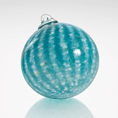 Capri by Jacob Pfeifer: Art Glass Ornament available exclusively at www.artfulhome.com Reminiscent of the Mediterranean Sea, this blown glass ornament ripples with waves of azure.