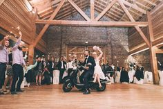 Bride & Groom portrait on a moped motorcycle | Bride in a Gilles Zimmer Wedding Dress | Pink Rose Flower Crown | Rustic Barn Wedding | Destination France Wedding | Images From Julien Navarre | http://www.rockmywedding.co.uk/marie-robin/