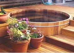How lovely would a cedar hot tub be on my balcony in addition to a balcony garden?!
