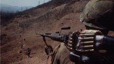 Machine gun at the ready. South Vietnam, 1968.