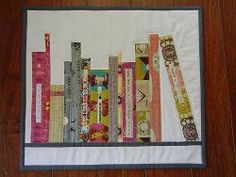 Mini Bookshelf Quilt~ dontcallmebetsy.blogspot.com  Delightful site!  Free patterns, tutorials ... easy to difficult. This one is easy so it's great for beginners.