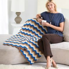 The Red Heart Ripple Throw Pattern is available from Yarnspirations. This throw is crocheted with Medium Weight Yarn [4] and a 6.5 mm (K) hook. The finished throw measures 45 inches X 54.5 inches.
