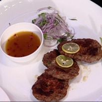 Peshawari Chappali Kebab Recipe - Minced lamb kebabs made from herbs, spices, eggs, pomegranate seeds and ginger. Served with an apricot-jaggery-raisin sauce.