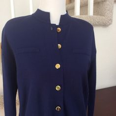 "Beautiful Royal Blue Wool Blend Dress This dress is a gorgeous royal blue accented with gold buttons on the front and sleeves. Faux breast pockets and pretty collar. Removable shoulder pads  70% acrylic; 30% wool  Bust 42""; hip 40""; length shoulder to hem 36"". This is a knit and has stretch  EUC. Only worn a couple times. No problems to report  Liz Claiborne Dresses Long Sleeve"