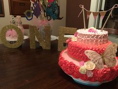 Gigi is one. Cakes. Pink and gold first birthday.