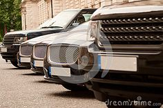 Luxury cars in a row as seen from a perspective