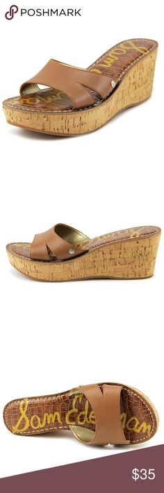 """Sam Edelman Reid Cork Wedge Sandal Adorable and easy cork Wedge sandal from Sam Edelman.  The Sam Edelman Reid Sandals feature a Leather upper with a Open Toe . The Man-Made outsole lends lasting traction and wear. Brand Color: Saddle (Main Color: Brown) Material: Leather Measurements: ~3"""" heel with a ~1.5"""" tie platform Width: B(M). The first three photos are stock photos and the last ones are of the actual shoe.  Does show small signs of wear but in GUC. These will be your summer go to…"""