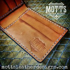 Interior shot of an MLD billfold.  I designed this wallet to be fully functional, with style and durability in mind.  I use high quality American made leather on these, from Hermann Oak Leather.  I completely hand stitch them, rather than that old store-bought machine stitching that usually frays withing just a couple months.  I do not use leather crafting kits.  I'm not a boy scout.  Each and every part is precisely cut from a hide here in my shop.