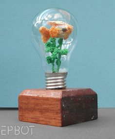 (knit) Fish in a light bulb.