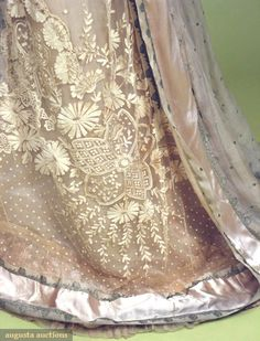 detailing from a Edwardian Paris gown (circa 1912).   Embroidered netting & silver metallic brocade.