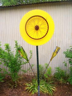 sunflower crafted from a large saw blade, bicycle rim, t-post, rebar and bottles.