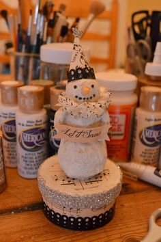 Vintage Folk Art Style Paper Mache Snowman Tutorial -- made with scraps and items from around the house -- aluminum foil, tissue paper, glue, acrylic paint, paper scraps.