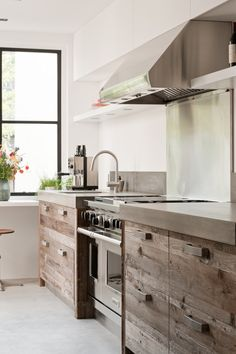 Concrete countertops, rough wood cabinets / drawers and stainless steel appliances complete this rustic modern kitchen design Home Design Decor, Küchen Design, House Design, Home Decor, Interior Design Ideas For Small Spaces, Modern Design, Loft Design, Kitchen Interior, New Kitchen