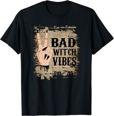 Bad Witch Vibes Halloween Shirt. Cool and trendy Halloween shirt with a witches hand with black fingernails making a peace sign. The bad witch vibes words are in a black gothic vampire style lettering. Background is a torn gothic vintage look. Makes a great fast and easy Halloween costume to celebrate Halloween.