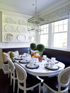Another banquette with a slimmer table and upholstered built-in benches.