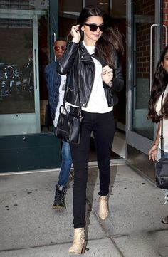 Kendall leaving Kanye's apartment with her friend heading to Kanye's concert in Philly.