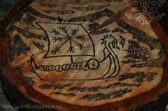 Vikings ship, Drakkar. Helmet of awe. Woodsburning.