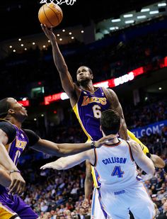 a5d81b14edf Los Angeles Lakers forward Earl Clark (6) fouls Oklahoma City Thunder  forward Nick Collison