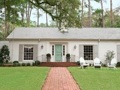 brick was painted James White and the front door Teresa's Green, both by Farrow & Ball, and the shutters DKC-8 by Donald Kaufman Color.