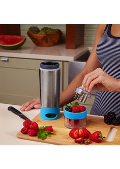 aqua zinger - $26 - water bottle that has grinder/mesh filter for fruit flavoured water  http://zinganything.com/product/aquazinger#