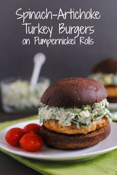 Spinach-Artichoke Turkey Burgers on Pumpernickel Rolls - Healthy turkey burgers topped with cheesy spinach-artichoke dip. | foxeslovelemons.com