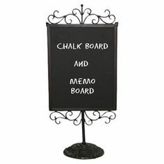 """Double-sided chalkboard on a scrolling metal stand.  Product: Chalkboard decorConstruction Material: Metal and chalkboardColor: BlackDimensions: 21.5"""" H x 9"""" W x 5.5"""" D Note: Assembly required. Chalk is not included."""