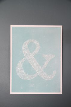 An 18x24 poster of an ampersand (Baskerville) made up of other ampersands, with some texture thrown in for good measure.