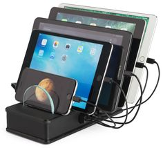 This USB charging station dock is a sleek, modern-styled hub for your mobile electronics. Check out for space-saving device chargers. Mobile Charging Station, Charging Stations, Monitor Stand, Usb Hub, Tech Gadgets, Innovation, Technology, Dividers, Mobiles