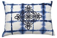 Mustique.. Shibori-dyed in a checkered pattern, this indigo-hued pillow is finished with a coordinating center medallion motif.