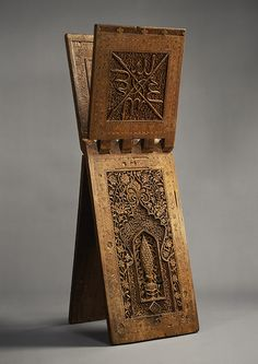 Stand for a Qur'an Manuscript. Zain(?) Hasan Sulaiman Isfahani  | dated A.H. 761/A.D. 1360  | Iran or Central Asia | Wood (teak); carved, painted, and inlaid