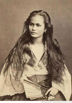 Circa 1875. Portrait of a 'Mestiza de Sangley' woman. Sangley is an archaic term used in the Philippines to describe and classify a person of pure Chinese ancestr