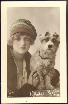 EARLY 1900S ENGLISH REAL PHOTO POST CARD, ACTRESS GLADYS COOPER WITH HER DOG