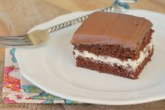 Chocolate Cream-Filled Cake - this cake tastes just like a Little Debbie Swiss Cake Roll! Layers of chocolate cake with vanilla cream filling and Chocolate Roll Cake, Chocolate Buttercream, Chocolate Cream, Chocolate Desserts, Sweet Recipes, Cake Recipes, Dessert Recipes, Pastry Recipes, Just Desserts