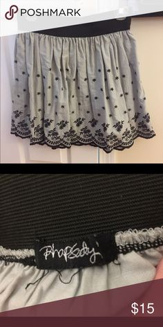 Gray and black scalloped skirt Gray skirt with scalloped bottom and dark blue flower designs. Very stretchy black elastic band. Size medium/large Rhapsody Skirts