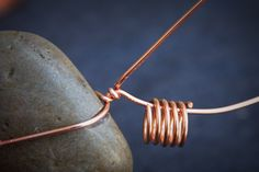 How to make a rain chain from copper wire and polished stones.