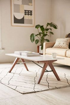 The Spirit Coffee Table includes a dash of industrial element with cross-shaped metal suspensions that unify the table that is reminiscent of mid-century modern design.