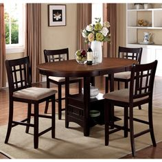 Dine in style with this Splendor five-piece counter-height dining set. The espresso finish adds an elegant look to your dining room, and the 18-inch extension leaf lets you accommodate more guests when you're having a party.