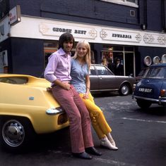 Pink trousers ahoy! George Best and his fiancee Eva Haraldsted outside his clothing boutique on Manchester's Bridge Street, 1969