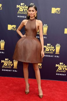 Growing up: The Greatest Showman's Zendaya Coleman put on quiet a sideshow in a brown leather halter August Getty dress while posing on the red carpet of the MTV Movie & TV Awards in Santa Monica on Saturday Mtv Awards 2018, Mtv Movie Awards, Zendaya Coleman, Moda Zendaya, Zendaya Style, Cool Outfits, Fashion Outfits, Dress Fashion, Fashion Ideas