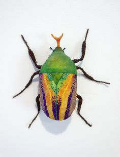 bug2 Textile Sculptures by Yumi Okita.  Thought this was real, but it's a sculpture of some type of beetle.