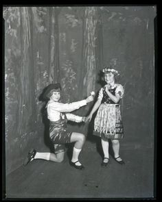 Norma Rothenbuecher and Anita Saussele posing in traditional costumes at German House, 2345 Lafayette Avenue. Photograph taken by Isaac Sievers for Sievers Studio in 1931. Sievers Studio Collection, Missouri History Museum.