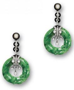 A pair of jadeite, onyx and diamond earrings Each suspending a bright emerald green jadeite hoop carved as a dragon, with onyx and brilliant-cut diamond fringed connections and similarly set rondelle spacers and terminals, mounted in 18k blackened gold.